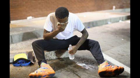 A man fights the effects of tear gas in Ferguson on August 17, 2014.