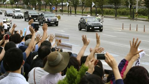 Pope Francis waves to South Koreans from inside a vehicle near the Seoul Air Base in Seongnam, South Korea, on Monday, August 18.