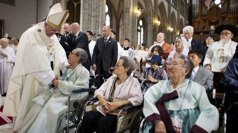 """This handout picture released by the Osservatore Romano shows Pope Francis (L) meeting with former """"comfort women"""", Koreans forced to work in Japanese wartime military brothels, prior to celebrate a mass for peace and reconciliation at the cathedral on August 18, 2014 in Seoul. Pope Francis wrapped up the first papal visit to Asia in 15 years on August 18, urging the divided Koreas to reject suspicion and confrontation and unite as """"one family, one people"""".   AFP PHOTO / OSSERVATORE ROMANO -RESTRICTED TO EDITORIAL USE - MANDATORY CREDIT """"AFP PHOTO / OSSERVATORE ROMANO"""" - NO MARKETING NO ADVERTISING CAMPAIGNS - DISTRIBUTED AS A SERVICE TO CLIENTS"""