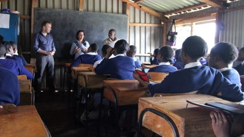 The Kibera Girls Soccer Academy is a free public school for girls (and now some boys). Worldreader co-founder Colin McElwee, left, talks to a class on a recent visit.