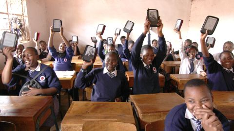 """Academy students show off their Kindle e-readers. """"The Kindle is very important,"""" said Abdul Kassim, the school's founder and executive director. """"It means their life."""""""