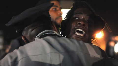 A demonstrator shouts during a protest on West Florissant Avenue, one of Ferguson's main streets, on August 18, 2014.