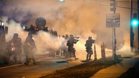 Police try to control protesters on Monday, August 18, 2014.