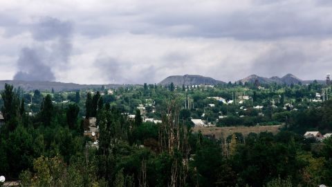Clouds of smoke are on the horizon as Ukrainian forces and pro-Russian rebels clash in Yasynuvata, Ukraine, on Tuesday, August 19.