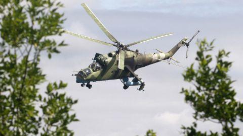 An Ukrainian helicopter flies near Kramatorsk on August 19.