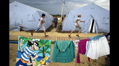 Boys play at a refugee camp, set up by the Russian Emergencies Ministry, near the Russian-Ukrainian border on August 18.