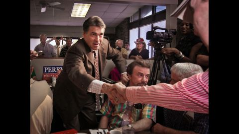 In the inaugural stages of his 2012 presidential run, Perry mingles with a breakfast crowd during a campaign stop at Bazen's Family Restaurant in Florence, South Carolina, on August 19, 2011.