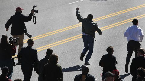 Perry runs the Veterans Day parade route in Columbia, South Carolina, while local media and his security detail jog along to keep up on November 11, 2011.