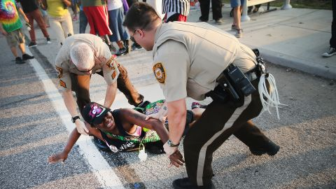 A demonstrator is arrested while protesting the killing of teenager Michael Brown on August 19 in Ferguson, Missouri. Brown was shot and killed by a Ferguson police officer on August 9.