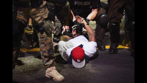 Police arrest a demonstrator on August 19, 2014.
