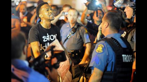 A protester speaks to a police officer on August 19, 2014.