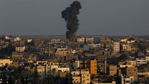 Smoke and dust rise after an Israeli air strike hit Gaza City on August 19.