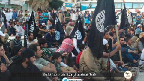 """ISIS celebrates announcement of their """"Caliphate."""" Caption: This photo was tweeted from a Twitter account widely believed to belong to ISIS in Aleppo, Province, Syria. It purportedly shows celebrating ISIS' announcement of the so called Islamic Caliphate, spanning large areas of Iraq and Syria. The Islamic State in Iraq and Syria (ISIS) is a Sunni Muslim extremist group formerly linked to al-Qaeda-- al Qaeda has since denounced ISIS."""