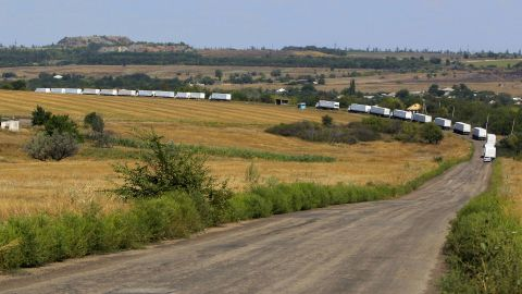 """The first trucks of a Russian aid convoy roll on the main road to Luhansk in eastern Ukraine on Friday, August 22. The head of Ukraine's security service called the convoy a """"direct invasion"""" under the guise of humanitarian aid since it entered the country without Red Cross monitors."""