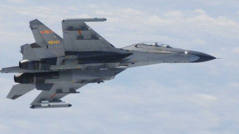 """This picture taken and released by Japan's Defence Ministry on June 11, 2014 and received via Jiji Press shows one of two Chinese Su-27 fighter jets which flew """"dangerously"""" close to two Japanese military planes over the East China Sea. Japan accused China of flying fighter jets """"dangerously"""" close to two of its military planes over the East China Sea on June 11, as bilateral tensions simmer over the countries' territorial dispute. On June 12, Japan summoned the Chinese ambassador to complain about the fighter jets activities.    JAPAN OUT     AFP PHOTO/Defense Ministry via Jiji Press --- EDITORS NOTE -- RESTRICTED TO EDITORIAL USE - MANDATORY CREDIT """"AFP PHOTO / AFP PHOTO/Defense Ministry via Jiji Press""""- NO MARKETING NO ADVERTISING CAMPAIGNS - DISTRIBUTED AS A SERVICE TO CLIENTSJIJI PRESS/AFP/Getty Images"""