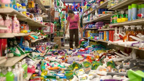 Nina Quidit cleans up the Dollar Plus and Party Supplies Store on August 24 in American Canyon, California, after the earthquake wreaked havoc on the store's shelves.