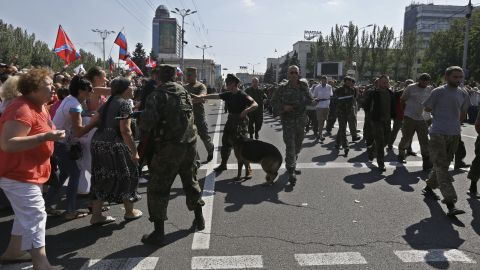 People yell as Ukrainian prisoners are paraded through Donetsk in eastern Ukraine on August 24.
