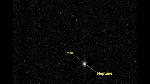 In August 2014, New Horizons crossed the orbit of Neptune, the last planet it would pass on its journey to Pluto. New Horizons took this photo of Neptune and its large moon Triton when it was about 2.45 billion miles from the planet -- more than 26 times the distance between the Earth and our sun.