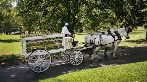 Brown's casket arrives at Saint Peters Cemetery in St. Louis.