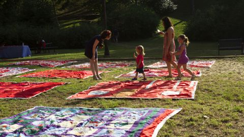 Organizers estimate that nearly 200 people turned up in Birmingham, Alabama, for the display of the Monument Quilt in Rushton Park.