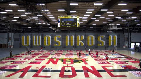 """The quilt visited the University of Wisconsin-Oshkosh on August 19, where organizers used fabric to form the words """"Not Alone."""" The Oshkosh visit was coordinated by REACH Counseling and the University of Oshkosh Women's Center."""