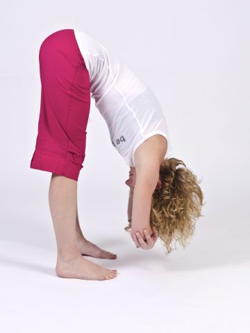 Ragdoll pose assists with proper pelvic alignment, hip hinging and hamstring lengthening.