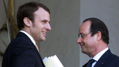 Emmanuel Macron, left, here in 2014, left the government of President  François  Hollande in August.