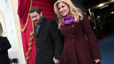 """At first, <a href=""""http://marquee.blogs.cnn.com/2013/08/22/kelly-clarkson-who-needs-a-wedding/?iref=allsearch"""" target=""""_blank"""">Kelly Clarkson tried to trick us into believing</a> that she and Brandon Blackstock wouldn't have a wedding, and instead would just elope. But in October 2013, <a href=""""http://www.cnn.com/2013/10/21/showbiz/kelly-clarkson-wedding/index.html?iref=allsearch"""" target=""""_blank"""">she shared photos of herself and her new husband</a> getting hitched at Blackberry Farms in Tennessee."""