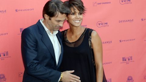"""The world knew that Halle Berry was planning to marry French actor Olivier Martinez <a href=""""http://marquee.blogs.cnn.com/2012/03/12/halle-berry-olivier-martinez-officially-engaged/?iref=allsearch"""" target=""""_blank"""">as of March 2012</a> -- when Martinez himself let the news slip -- but <a href=""""http://marquee.blogs.cnn.com/2012/04/17/halle-berry-on-engagement-never-say-never/?iref=allsearch"""" target=""""_blank"""">Berry didn't talk about it until weeks later</a>. The couple's moves toward the altar were closely tracked, which meant that even though they didn't talk about it, we still knew they were <a href=""""http://www.cnn.com/2013/07/14/showbiz/halle-berry-marriage/index.html?iref=allsearch"""" target=""""_blank"""">tying the knot in a private affair in France in July 2013.</a>"""