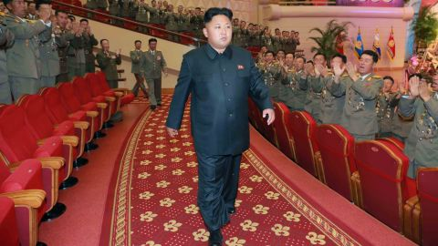This undated picture released by North Korea's official Korean Central News Agency (KCNA) on July 28, 2014 shows North Korean leader Kim Jong-Un (C) with Korean People's Army (KPA) service personnel, attending a performance given by the State Merited Chorus at the People's Theatre in Pyongyang.