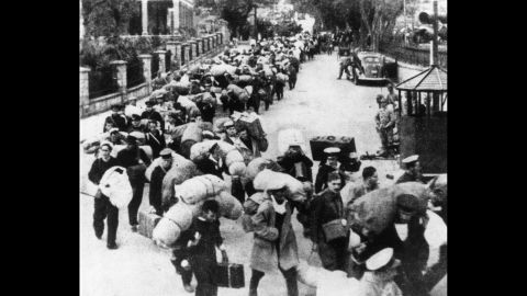 British prisoners of war leave Hong Kong for a Japanese prison camp in December 1941.