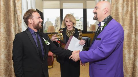 """Rivers officiates the wedding of William """"Jed"""" Ryan, left, and Joseph Aiello at the Plaza Athenee on August 15 in New York."""