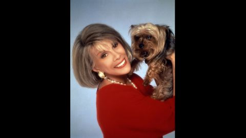"""She starred on the daytime """"Joan Rivers Show,"""" for which she won a Daytime Emmy, for five seasons, from 1989-1994. Here, she poses with her dog, Spike."""
