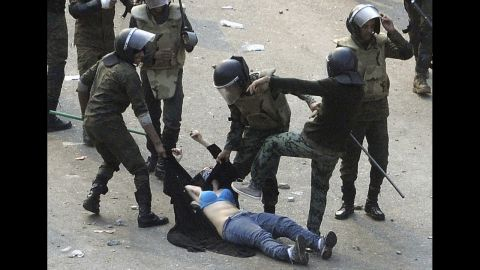 Egyptian army soldiers arrest a female protester during clashes at Tahrir Square in Cairo on December 17, 2011. On January 25, people took to the streets in demonstrations against corruption and failing economic policies. From the beginning, the revolution in Egypt was propelled by the use of social media. The events in Egypt served as a flash point for journalists on the ground, too. For perhaps one of the first times, history itself has been recorded instantaneously, as reporters took to Twitter to share 140-character updates and personal stories from the protests.