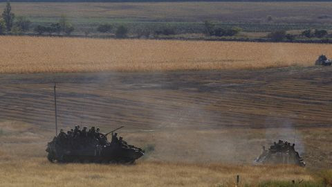Ukrainian troops leave the rebel-held town of Starobesheve on Saturday, August 30.
