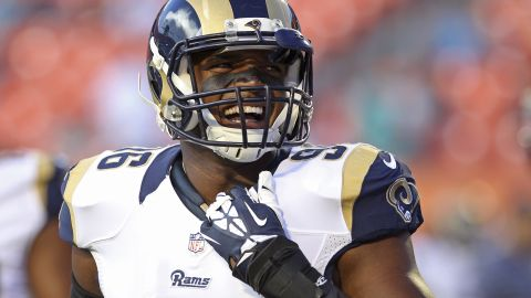 MIAMI GARDENS, FL - AUGUST 28:  Defensive end Michael Sam #96 of the St. Louis Rams reacts during pregame workouts before his team met the Miami Dolphins at Sun Life Stadium on August 28, 2014 in Miami Gardens, Florida.  (Photo by Marc Serota/Getty Images)