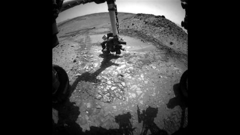 """This image shows the Curiosity rover doing a test drill on a rock dubbed """"Bonanza King"""" to see if it would be a good place to dig deeper and take a sample. <a href=""""https://www.nasa.gov/mission_pages/msl/index.html"""" target=""""_blank"""" target=""""_blank"""">Curiosity was launched in 2011</a>, and it is the most advanced rover ever built. It's helping scientists determine whether Mars is, or ever was, habitable for life forms."""