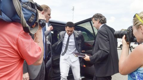 <strong>June 2014:</strong> The singer gets ready to enter a Washington courthouse for a hearing in his misdemeanor assault case stemming from an October 2013 sidewalk fight in the nation's capital. Brown rejected a plea deal at that time.