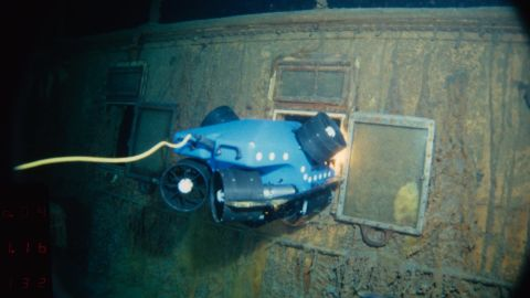 """For the Titanic dives, a prototype Remotely Operated Vehicle called """"Jason Jr."""" was deployed to photograph the wreck. Here you can see Jason Jr. peering into the stateroom on the Titanic."""