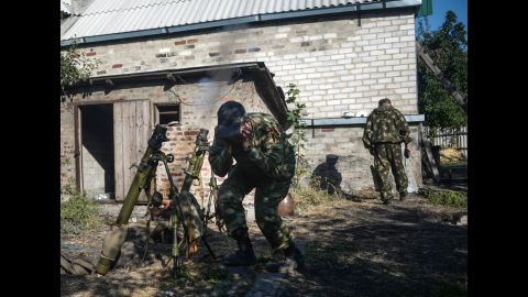 Pro-Russian rebels fire at Ukrainian army positions in Donetsk on September 3.