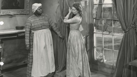 """In an iconic scene from the movie, Scarlett (Vivien Leigh) yanks down her mother's curtains for Mammy (Hattie McDaniel) to make a fancy dress to impress Rhett Butler and try to persuade him to give her $300 to pay the taxes on her plantation. """"The curtain dress has a special place in everyone's hearts,"""" says Jill Morena, the Ransom Center's assistant curator for costumes and personal effects."""
