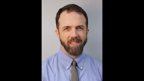 Univ. of Massachusetts staff photo of Dr. Rick Sacra, 51. Sacra was the third American to test positive for Ebola. He was working as a missionary doctor in Liberia. He was not treating Ebola patients, but rather delivered babies at a hospital in Monrovia, Liberia.