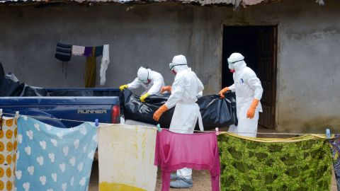 Medical workers of the Liberian Red Cross, wearing protective clothing, carry the body of a victim of the Ebola virus in a bag on Thursday, September 4, in the small city of Banjol, Liberia, about 20 miles from the capital of Monrovia.