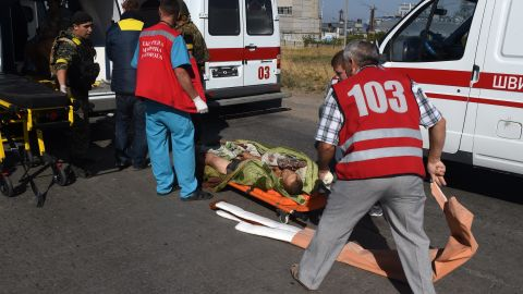 A wounded Ukrainian soldier is helped by a medical team on the outskirts of Mariupol on September 5.