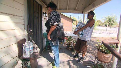 Donna Johnson, left, and a helper go door-to-door.