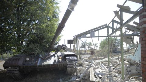 A destroyed tank sits near the wreck of a building in the village of Talakovka, some 22 kms northeast of Mariupol, on September 6, 2014, a day after the signing of a 12-point pact backed by both Kiev and Moscow to end a conflict, which triggered the most serious crisis between Russia and the West since the Cold War. Ukraine said on September 6 that a truce was largely holding in the war-battered east, despite fears it may ultimately fail to halt a pro-Russian insurgency still threatening to tear the country apart. AFP PHOTO/ ALEXANDER KHUDOTEPLY (Photo credit should read Alexander KHUDOTEPLY/AFP/Getty Images)