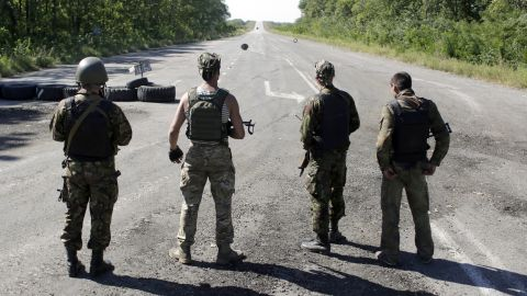 Ukrainian troops stand on a deserted road as they patrol the border area of the Donetsk and Luhansk regions Friday, September 5, near Debaltseve.