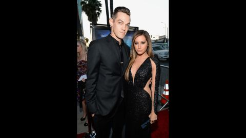 """When """"High School Musical"""" star Ashley Tisdale married musician Christopher French on September 8, she reportedly had a plan in place to keep the ceremony private.<a href=""""http://www.eonline.com/news/577514/ashley-tisdale-and-christopher-french-couldn-t-have-looked-happier-wedding-details-and-a-new-pic-of-the-bridal-party"""" target=""""_blank"""" target=""""_blank""""> According to E!</a>, the couple had guests arrive at a different location before shuttling them over to the wedding's private venue."""