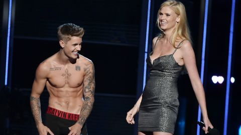 """Justin Bieber is a documented fan of public shirtlessness and <a href=""""http://www.mtv.com/news/1712168/justin-bieber-sings-naked-grandmother/"""" target=""""_blank"""" target=""""_blank"""">singing songs to his grandmother in the nude</a>. We can now also call the """"Baby"""" singer a fan of the public striptease. At the 2014 charity event Fashion Rocks, Bieber removed everything but his underwear while on stage with co-presenter Lara Stone, explaining that he just didn't feel comfortable unless he was in his """"Calvins."""""""