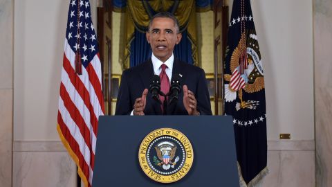 """US President Barack delivers a prime time address from the Cross Hall of the White House on September 10, 2014 in Washington, DC.  Vowing to target the Islamic State with air strikes """"wherever they exist"""", Obama pledged to lead a broad coalition to fight IS and work with """"partner forces"""" on the ground in Syria and Iraq.  AFP PHOTO/POOL/Saul LOEB        (Photo credit should read )"""